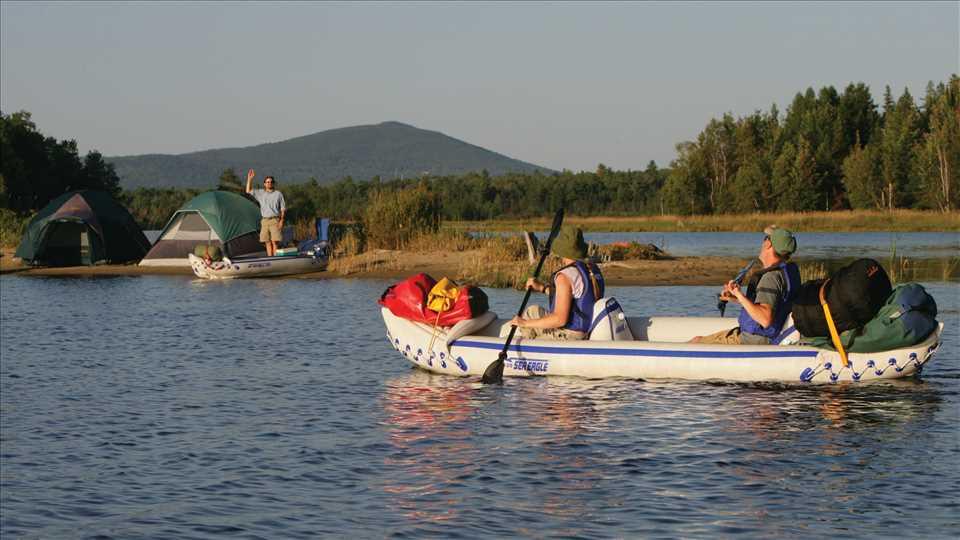 Group of people enjoying the lake